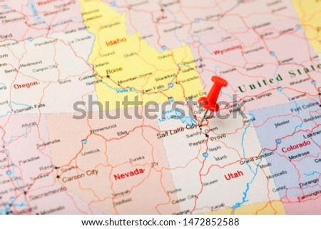 Red clerical needle on a map of USA, Utah and the capital Salt Lake City. Closeup Map Utah with Red Tack #1472852588