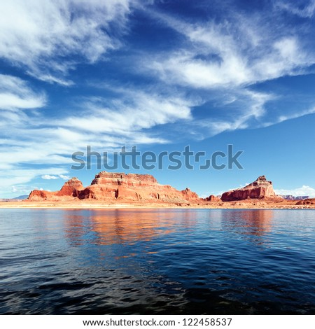 red cliffs reflected in the water of the lake Powell