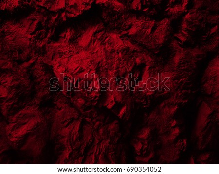 Red Close up rocks. Dark Stone texture.                                   #690354052