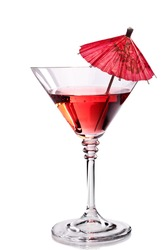 Red cocktail in martini glass with umbrella