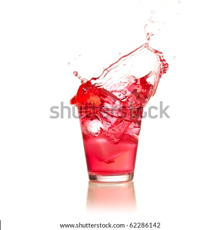 Red cocktail splashing on a glass on white background