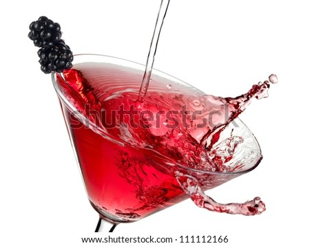 Red cocktail with blackberry plash