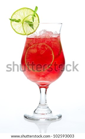 red cocktail with ice and lime