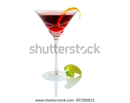 Red cocktail with lemon rind spiral garnish and lime wedge, isolated