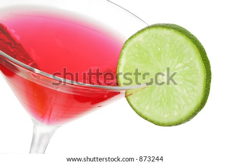 Red cocktail with lime slice garnish; isolated