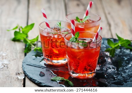 Red Cocktail with mint and ice, selective focus