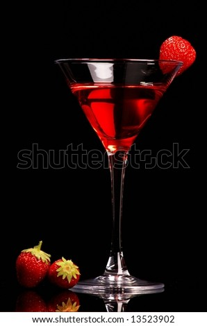 Red cocktail with strawberries on black background - stock photo