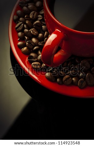red coffee cup and grain on black