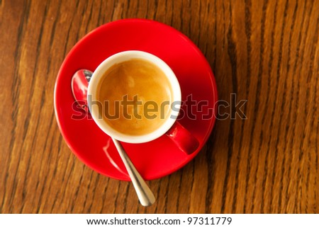 red coffee cup on the brown wooden table