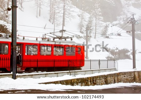 red cog train at station in snowy day at Chamonix, France