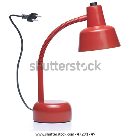 Red color desk lamp with electrical plug. Clipping path