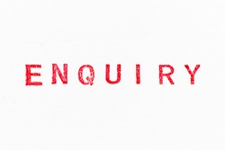 Red color ink rubber stamp in word enquiry on white paper background