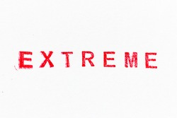 Red color ink rubber stamp in word extreme on white paper background
