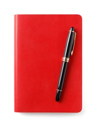 Red color leather cover notebook or note paper with black and gold shiny classic pen isolated on white background