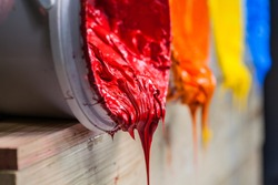 red color of plastisol ink flowed out of the barrel. plastisol ink is specially for print on tee shirts and any fabric. the ink useful in tee shirt factory garment and industry for export