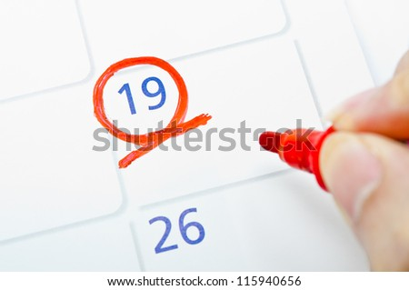 Red color writing on the calendar at 19.