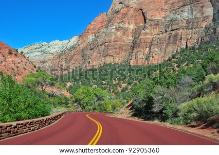 Red colored highway through Zion National Park in Utah in autumn