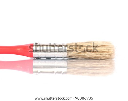 Red colored paintbrush over white background