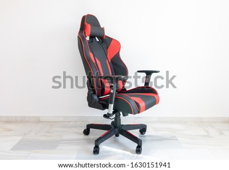 Red comfortable gaming and racing chair that can be used to play videogames online and on PC and console