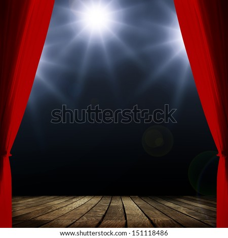 Red concert curtain and spots lighting over dark background and wood floor