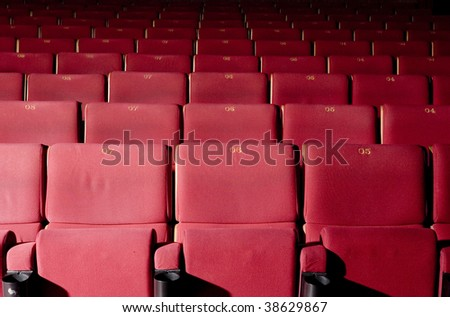 Red concert hall, opera or theater seats.