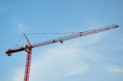 Red Construction Crane with blue sky