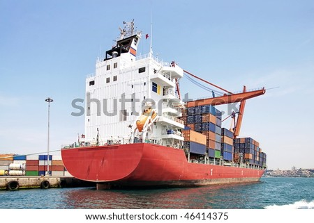 Red container ship at harbor