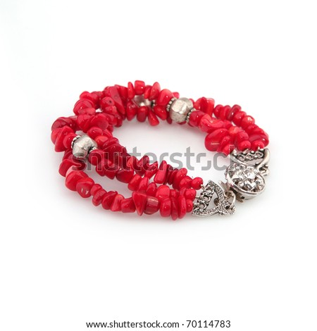 Red coral bracelet isolated on white - stock photo