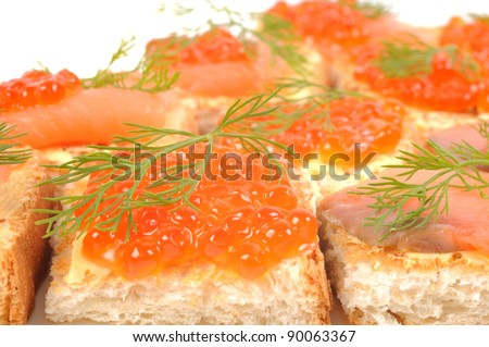 Red coviar and smoke salmon canape , close up shot