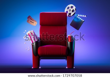 Red Cozy Cinema Armchair With Comfortable Elbows Near Popcorn Bowl, Tickets, Film Reel And Movie Clapper. 3d Rendering