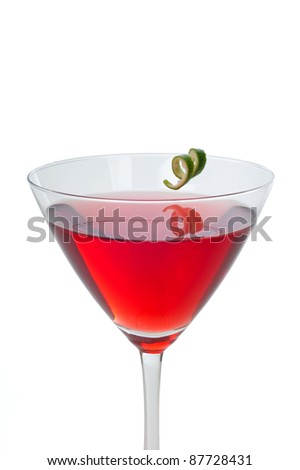 Red cranberry martini with a twist of lime garnish isolated on white