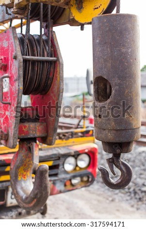 Red Crane Hook 25t isolated \ An hoist on top industry place .\ Big metal hook with chain isolated