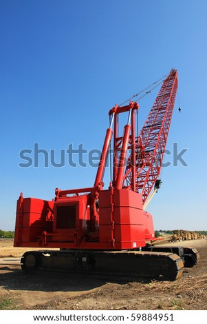 red crane on construction site
