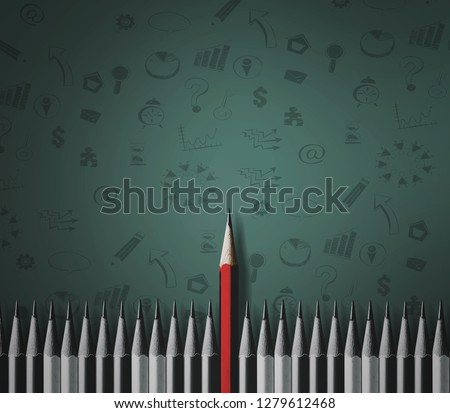 Red crayons stand out from the many black crowds that are alike on the green floor. Leadership, icons, identity, independence, originality, strategy, conflict, different ideas, way Business #1279612468