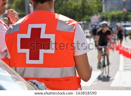 Red cross of Ambulance man on bicycles race