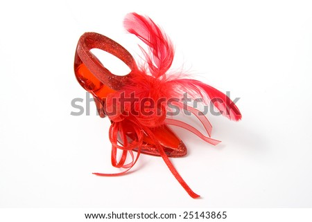 Red crystal slippers with feathers, isolated on white