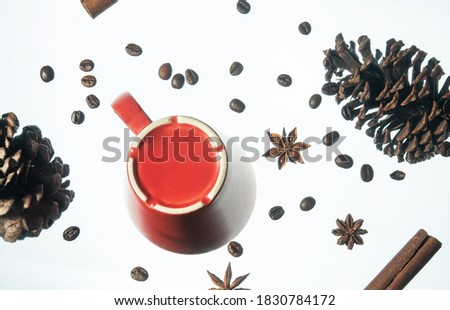 Red cup, coffee, cinnamon and cones - bottom view