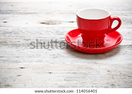Red cup coffee on wood background