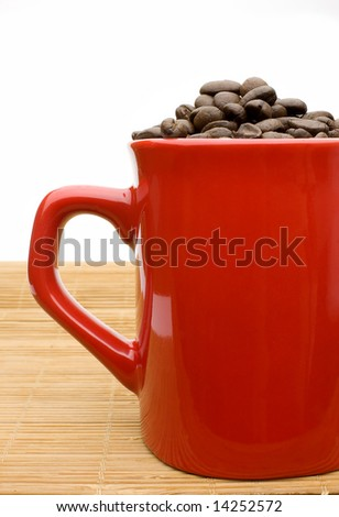 red cup filled with coffee beans