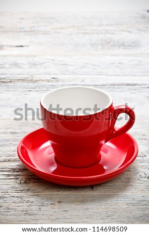 Red cup on wood background