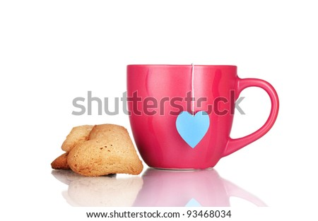 red cup with tea bag and heart-shaped cookies isolated on white