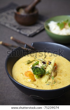 red curry soup with vegetables and travel