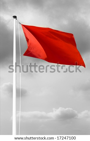 Red danger flag at the beach before a storm or hurricane
