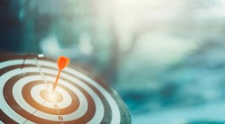 Red dart arrow hit on bulleyes center represent accuracy of strategy marketing planning for achieve objective target, success goal business marketing concept with copy space