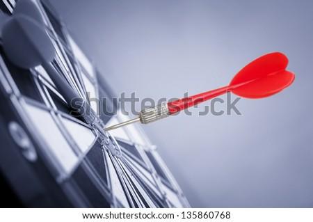 Red Dart Arrow in center of target