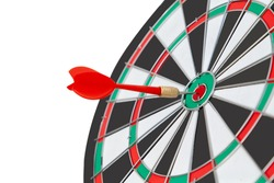Red dart arrow target on center of dartboard isolated on white. Goal, success, business strategy, new year resolution and focus concept. Selective focus