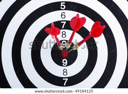 Red dart struck directly in center of target. - stock photo