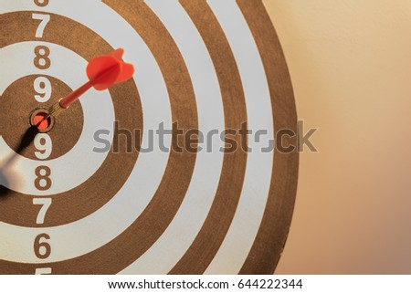 red dart target arrow hitting...