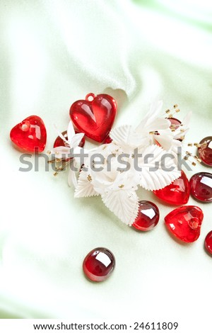 red decoration, artificial flower, pebbles and heart for valentine day