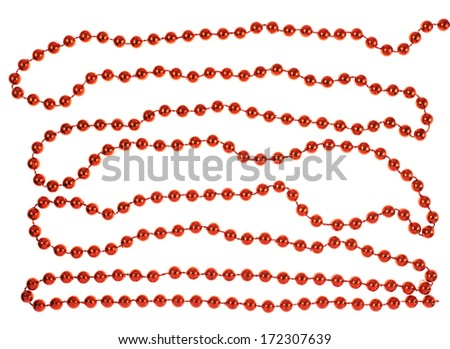 Red decoration beads on a string isolated over white background